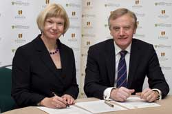 Professor April McMahon and Professor John Hughes signing the Strategic Alliance agreement